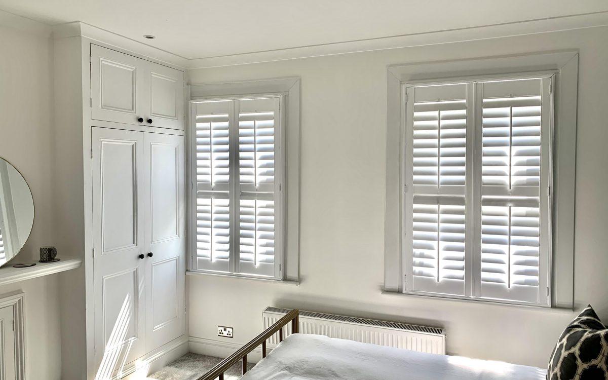 Tier-on-Tier Shutters in bright bedroom space